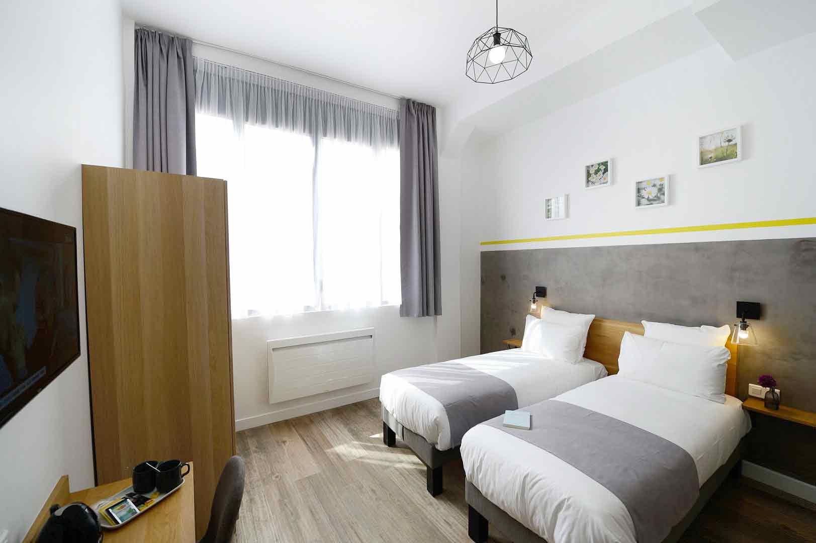 Chambre élégante avec lits jumeaux, de notre hôtel 3 étoiles à Paris, hôtel Terre Neuve